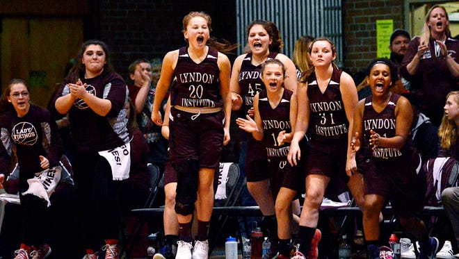 The Lyndon bench reacts during the second-seeded Vikings' 40-15 win over top-seeded Mill River in the Division II championship at Barre Auditorium on Saturday, March 18, 2017. It was the first-ever state title for the Lyndon girls hoops program. (Photo by Paul Hayes)