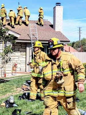 Crews battle a house fire Wednesday in Thousand Oaks. No one was injured by the fire, which was reported at 10:54 a.m. in the 300 block of Pepperwood Court and was knocked down at 11:21 a.m.