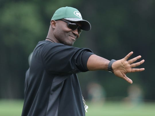 Head coach, Todd Bowles communicating with is players