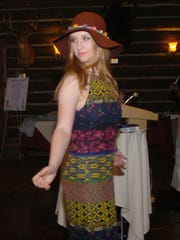 "Annika Taylor shows off her outfit at the ""Fashions Then and Now"" vintage fashion show."
