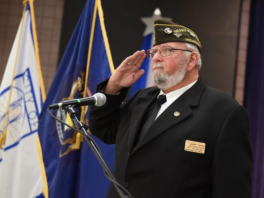 Barry Teagan, of Post 147 American Legion, salutes the Color Guard at Novi's Nov. 3 salute to veterans at the Civic Center.