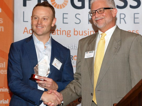 Ben Harrison, left, of Kaysun Corp., receives the Corporate