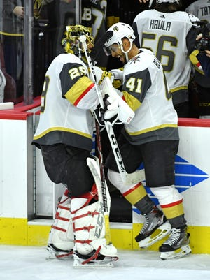 Vegas Golden Knights forward  Pierre-Edouard Bellemare (41) celebrates a win with goaltender Marc-Andre Fleury (29) against the Philadelphia Flyers at Wells Fargo Center.
