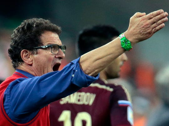 Russia's head coach Fabio Capello shouts and gestures during the group H World Cup soccer match between Algeria and Russia at the Arena da Baixada in Curitiba, Brazil, Thursday, June 26, 2014. (AP Photo/Ivan Sekretarev)