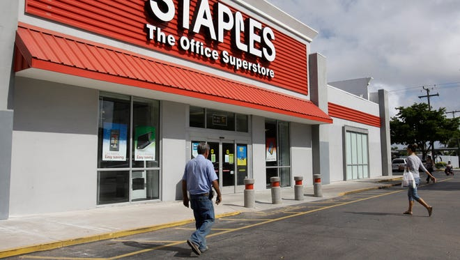This March 6, 2013, file photo shows a Staples office supply store in Miami.