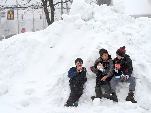 Tuesday's snow meant a day off from school. From left: