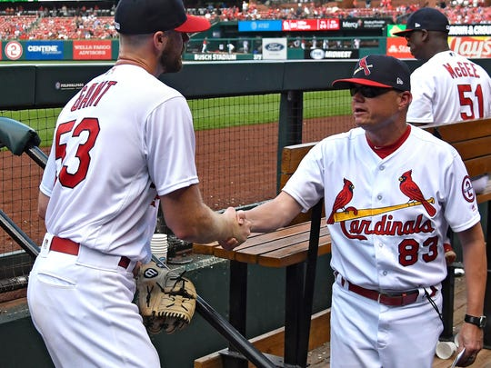Jul 15, 2018; St. Louis, MO, USA; St. Louis Cardinals interim manager Mike Shildt (83) congratulated relief pitcher John Gant (53) after his final inning of work during the eighth inning against the Cincinnati Reds at Busch Stadium. Mandatory Credit: Jeff Curry-USA TODAY Sports