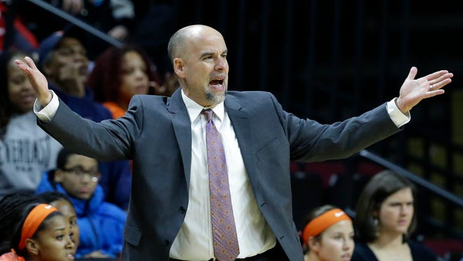 Illinois head coach Matt Bollant reacts to a call during the first half of a game against Rutgers.