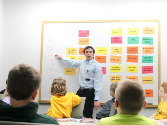 University of Iowa medical student Jacob Melendrez teaches Solon Middle School students about lung health during Junior Mini Medical School on Wednesday at the University of Iowa.