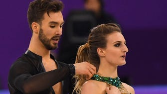 Gabriella Papadakis experiences a wardrobe malfunction as she and Guillaume Cizeron of France dance in the short program at the Olympics on Monday.