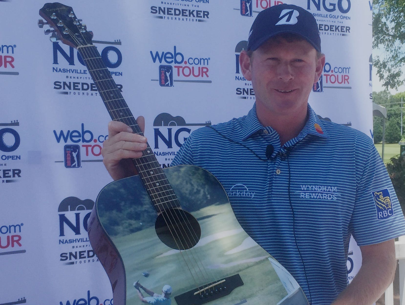 Brandt Snedeker shows off the guitar trophy for the Nashville Golf Open Benefiting the Snedeker Foundation, which begins Thursday at Nashville Golf and Athletic Club.