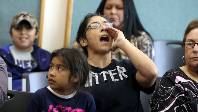 Corpus Christi resident Isabel Araiza chants during a news conference after city officials confirmed Thursday morning that one chemical contaminated the city's water supply on Thursday, Dec. 15, 2016, at Corpus Christi City Hall in Corpus Christi.