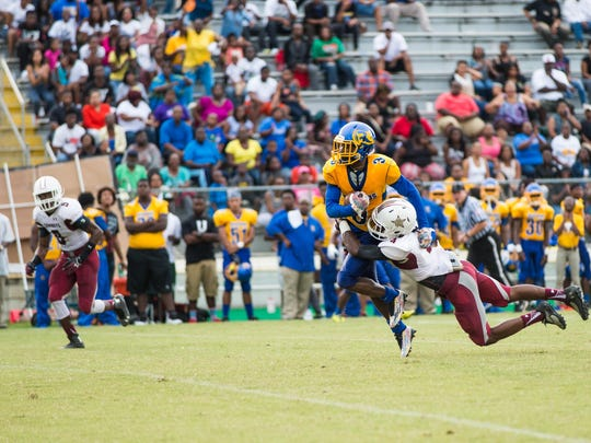 Rickards receiver Marcus Riley tries to shake loose