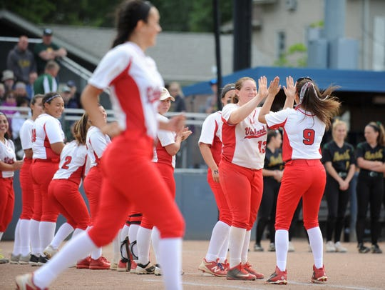 The Vineland softball team takes the field to take