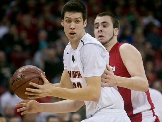 West De Pere's Cody Schwartz, left, against Mount Horeb's