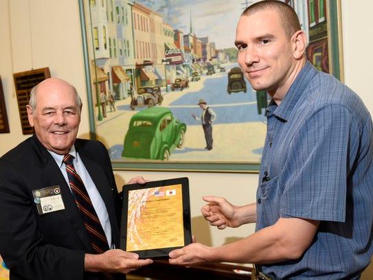 Charles Schlichter is congratulated by Mayor Darren