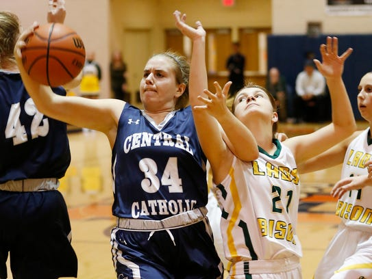 Jennifer Mills of Central Catholic grabs a rebound