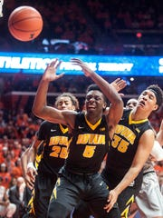 Iowa forward Tyler Cook (5) chases a loose ball with