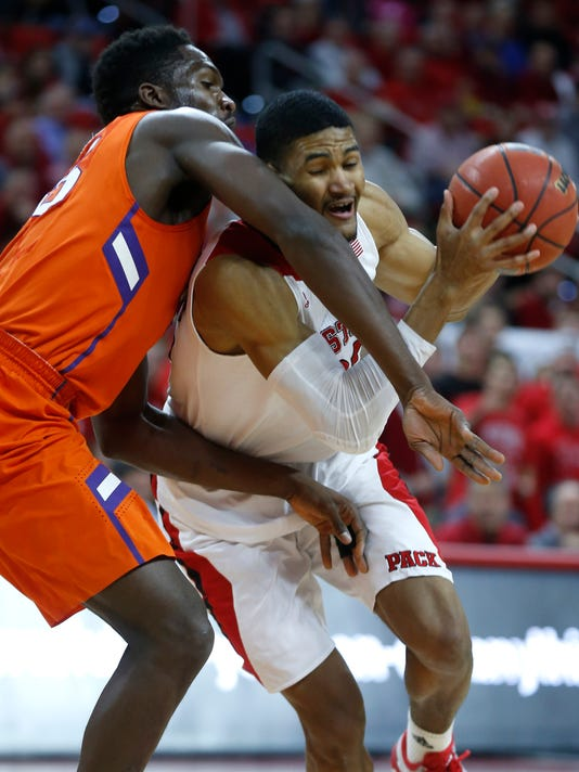 North Carolina State's Kyle Washington (32) goes around Clemson's Landry Nnoko (35) during the first half of an NCAA college basketball game, Wednesday, Jan. 28, 2015 in Raleigh, N.C. (AP Photo/The News & Observer, Ethan Hyman) MANDATORY CREDIT