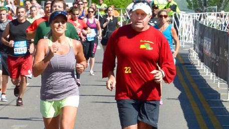Patriots coach Bill Belichick, left, and his fiancee', Linda Holliday, ran in the Country Music Half-Marathon in 2014.