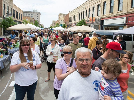 The Oshkosh Saturday Farmers Market draws in many people from the area June 14, 2014.
