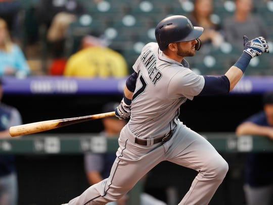 Seattle Mariners' Mitch Haniger follows the flight