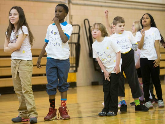 "Students, from left, Desiree Cumba, Emmanuel Abu, Aaron Janusz, Shane Bennett and Farhana Khan line up before the start of the ""Rock Your Socks"" event Friday at Claymont Elementary School. The event was to raise awareness about Down syndrome."