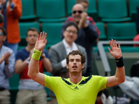 Britain's Andy Murray celebrates winning the third round match of the French Open tennis tournament against Germany's Philipp Kohlschreiber at the Roland Garros stadium, in Paris, France, Sunday, June 1, 2014. Murray won in five sets 3-6, 6-3, 6-3, 4-6, 12-10. (AP Photo/Darko Vojinovic)