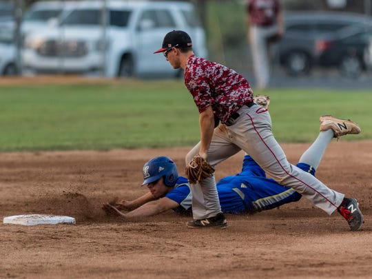 HendersonÕs Jacob Mulcahy (10) safely slides into second