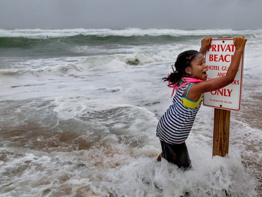Lailoni Kent, 8, of Lake Worth, screams when the pull