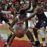 Guard Terrell Thompson is meet with double-team coverage on his way to the basket in the game against TTU.