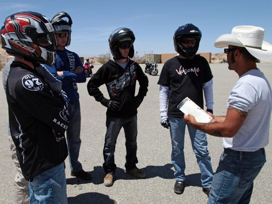 Frank Santiago, right, teaches the required Basic Rider Course covering motorcycle safety and riding techniques on April 30, 2013, at the Marine Corps Air Ground Combat Center in Twentynine Palms.