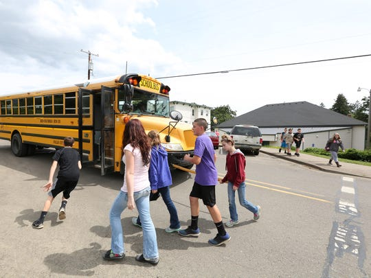 Fifth, sixth and seventh grade students leave a P.E. class on Wednesday, May 18, 2016, at the Falls City High School gym to board a bus back to the elementary school. Elementary and middle school students are bussed to the high school twice a week for P.E. classes.