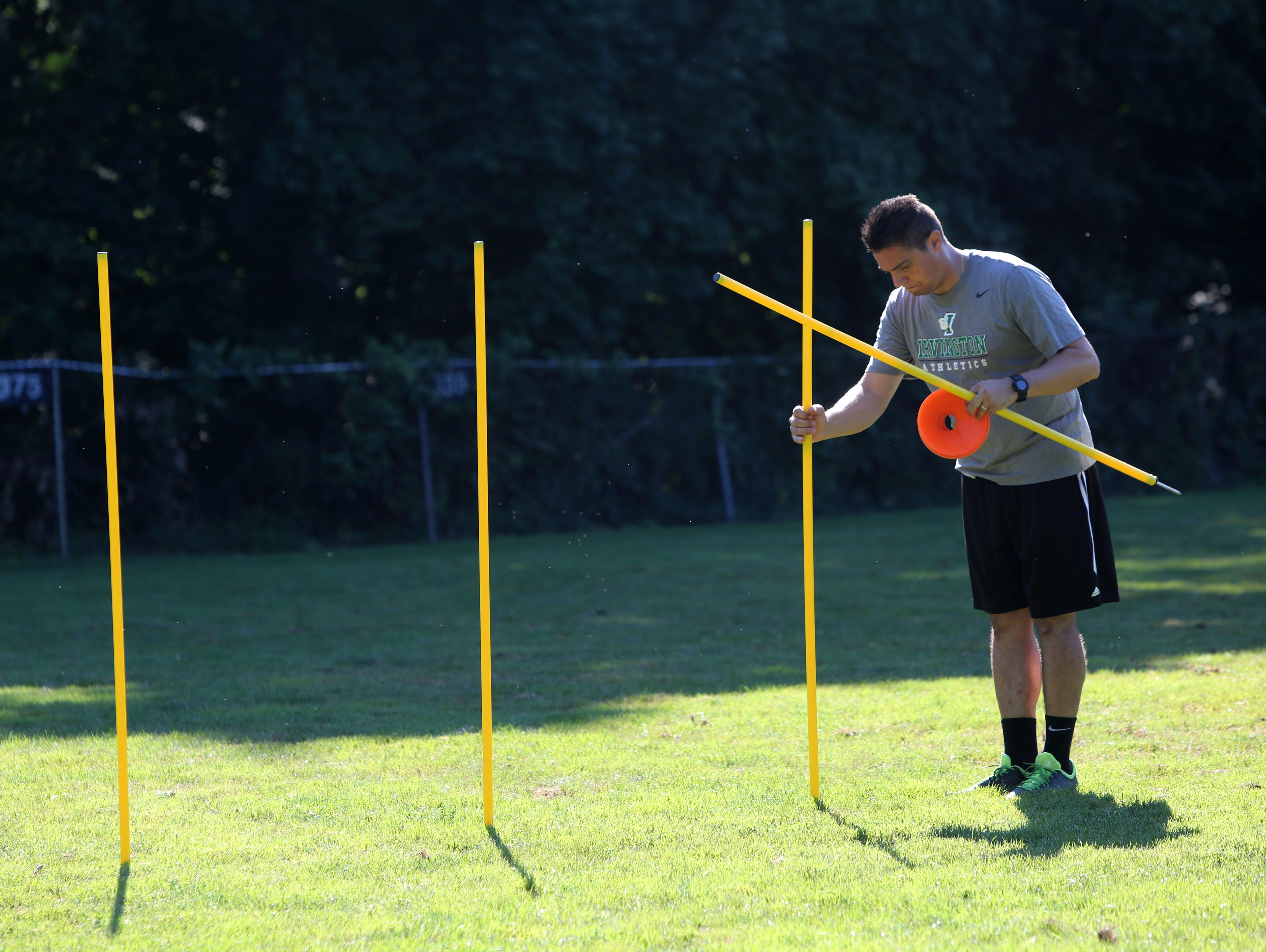 Irvington girls soccer coach Patrick DiBenedetto sets up a station for drills during practice Aug. 24, 2016 in Irvington.