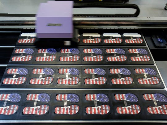 A design is printed on the tops of the soles at the Tidal New York factory in New Rochelle, Aug. 25, 2016. Tidal New York produces flip-flops locally with American sourced materials and is committed to hiring veterans.