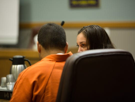 Philip Zaman, left, speaks to his attorney Monnica
