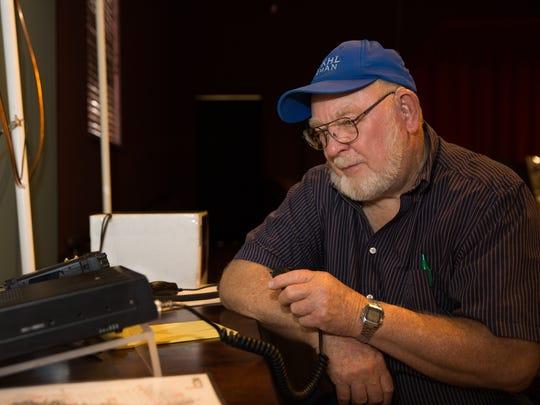 Radio club member Furman Smith uses his radio call