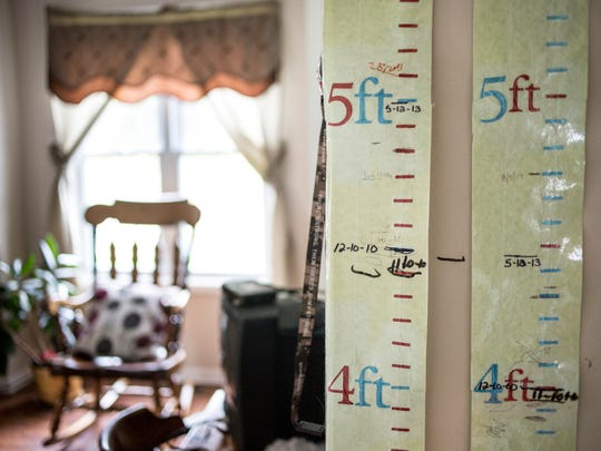 Growth charts are stuck to the wall in Bradley Moore's bedroom.