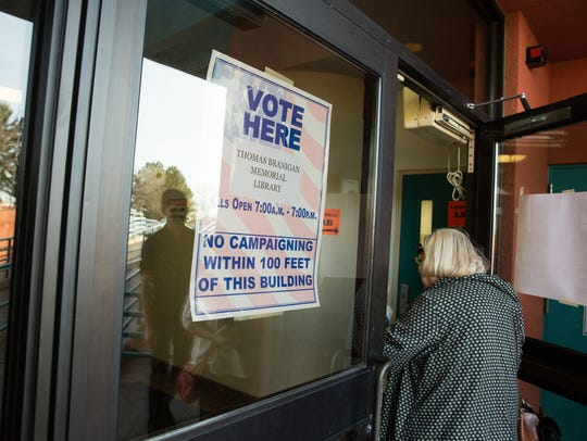 Voting officials at Branigan Memorial Library reported
