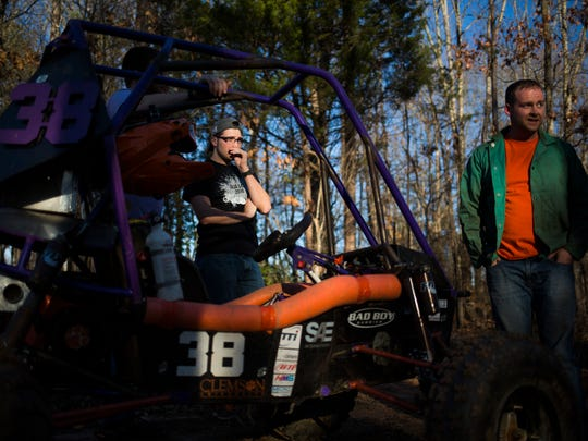 Junior Josh Fairbanks and other members of the Clemson University Society of Automotive Engineers access the damage done to their vehicle while off-roading on Friday, February 17, 2017 in Clemson.