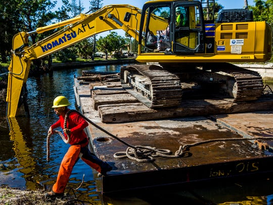 A work crew clears Hurricane Irma debris from the Imperial River in Bonita Springs on Tuesday, Dec. 26, 2017. The South Florida Water Management District is funding and operating the cleanup.