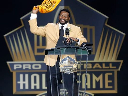 Former NFL player Jerome Bettis waves a Terrible Towel at the conclusion of his speech during inductions at the Pro Football Hall of Fame on Saturday in Canton, Ohio.