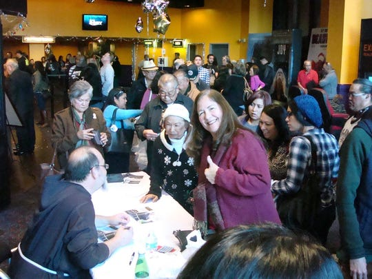 """Pale' Eric Forbes signs copies of the """"I Am Chamorro"""" DVD at the San Diego premiere of the documentary held Dec. 12 at Hazard Center theaters."""