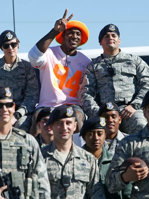 Broncos defensive end DeMarcus Ware poses with members of Security Forces during Pro Bowl team practice at Luke Air Force Base Thursday morning.