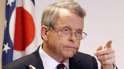 Ohio Attorney General Mike DeWine answers questions during a news conference in Steubenville, Ohio.