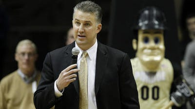 Purdue men's basketball coach Matt Painter, shown here addressing the Mackey Arena crowd on senior day, has been mentioned in speculation about the vacant Missouri head coaching job.