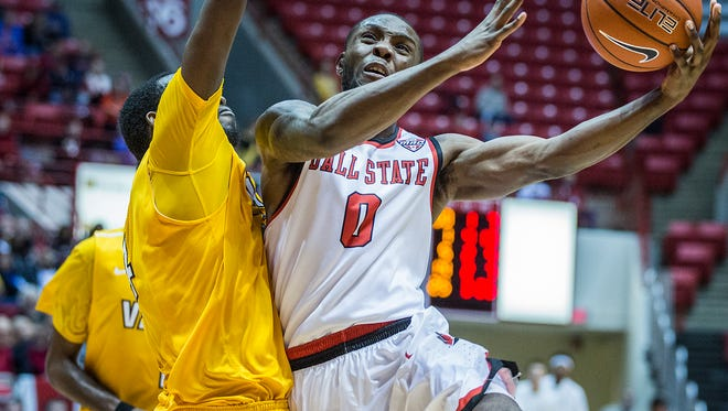 Ball State's Francis Kiapway looks for a shot past Valparaiso's defense during their game at Worthen Arena Saturday, Nov. 28, 2015.
