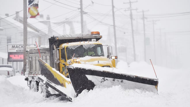 A PennDOT snow plow driver works to clear East Market Street in Hallam during a snowstorm last month. York County could see a wintry mix or snow next week from a potential storm.