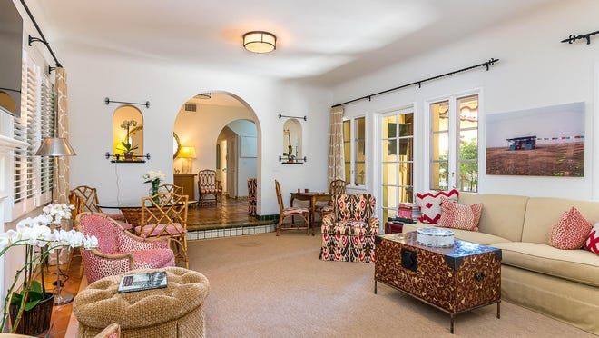 French doors lead from the living room to a private patio at the No. 4 condominium in landmarked Bienestar, a 1924 mansion converted into six condos in the 1980s.