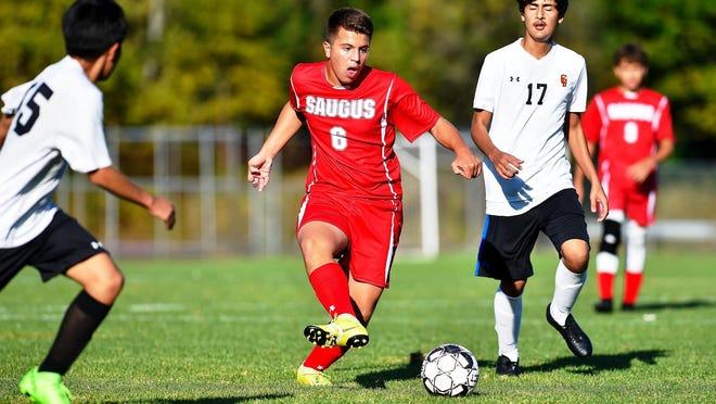 """Vincent Coluccio, shown playing in a game last fall, wants to begin his second year as a captain of the Saugus boys' soccer team, but he may have to wait until the """"Fall 2"""" portion of the 2020-2021 high school sports calendar in late February after the NEC principals voted to postpone the season until then, because of coronavirus concerns in some of the conference communities. But that might change after Salem and Saugus were upgraded out of the Red Zone since that vote."""